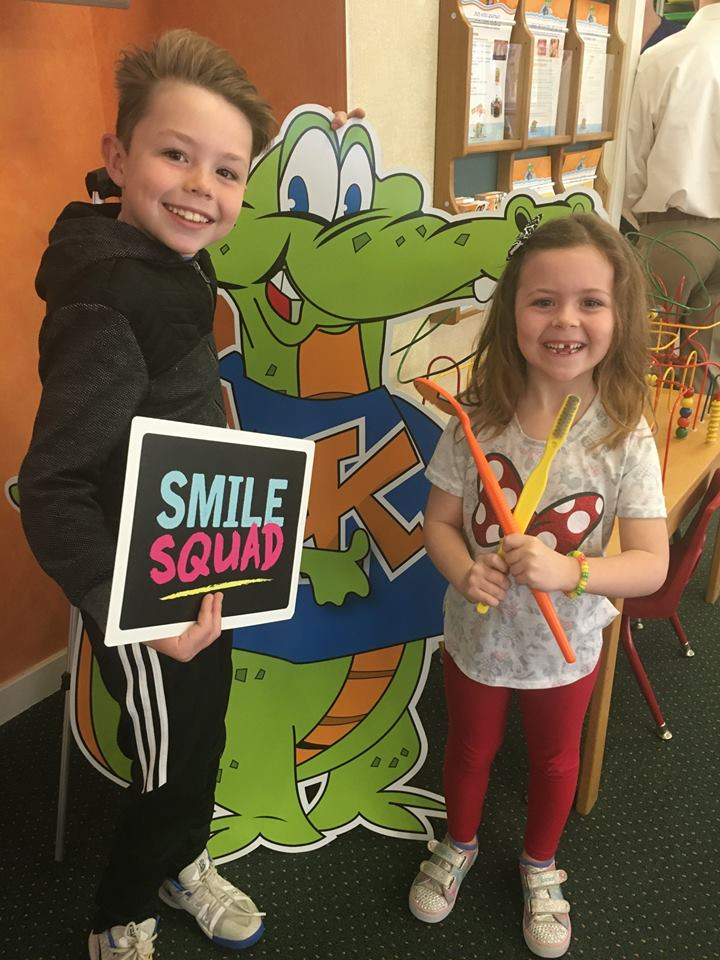 Two pediatric dentistry patients smile at Kidzdent