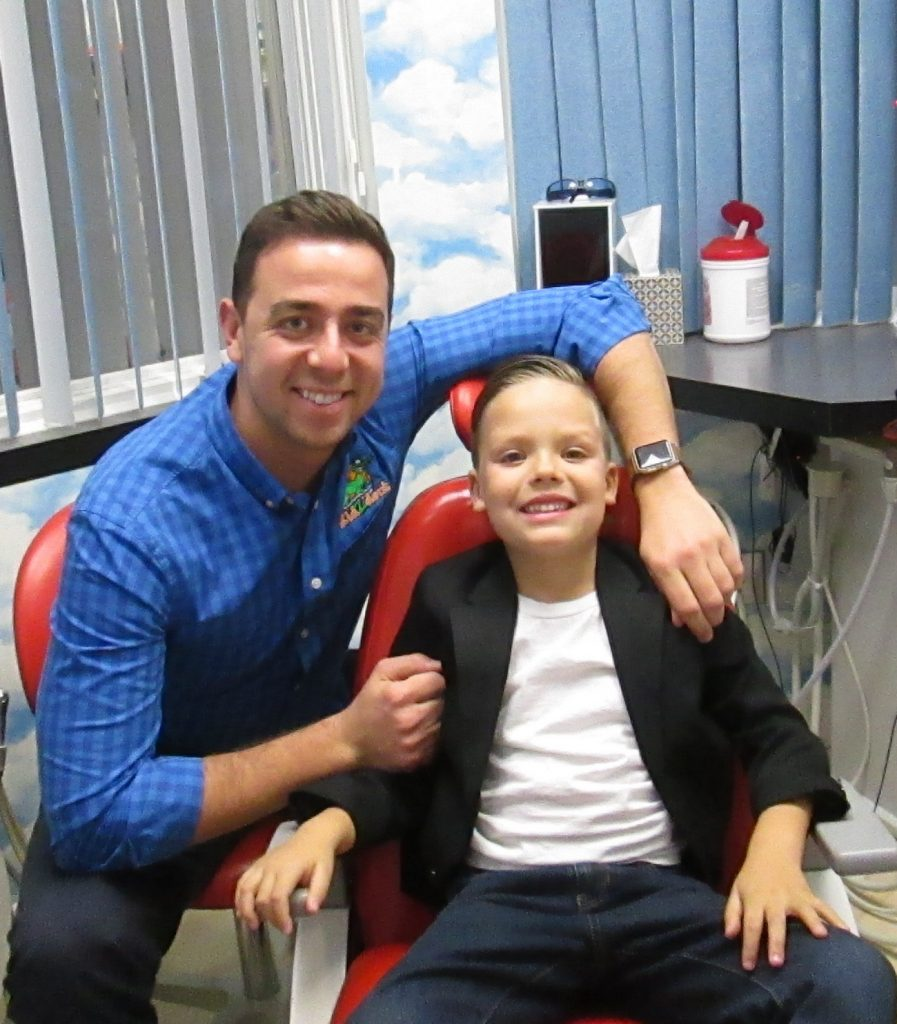 Dr. Paul Zeylikman smiling with pediatric dentistry patient