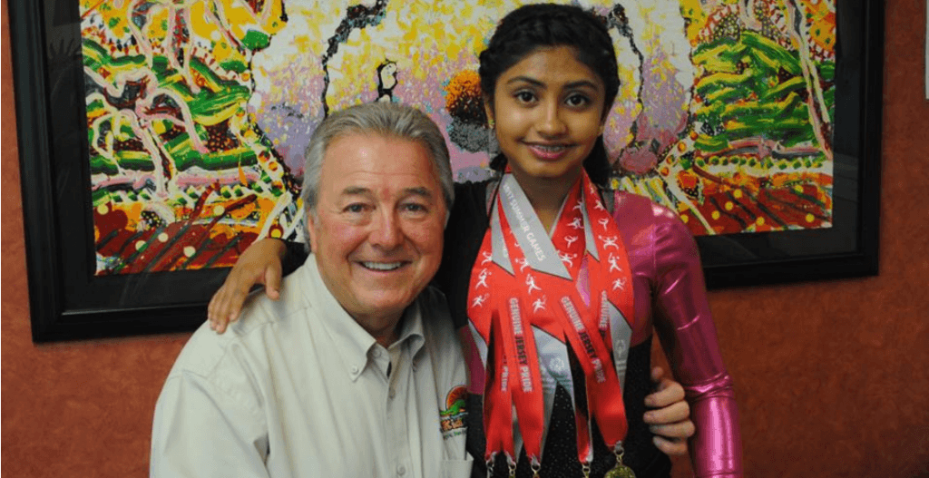 Dr. Cavan Brunsden posing for a photo with a patient at KidZdent