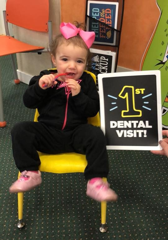 Pediatric patient smiling for her first visit to the Kidzdent office