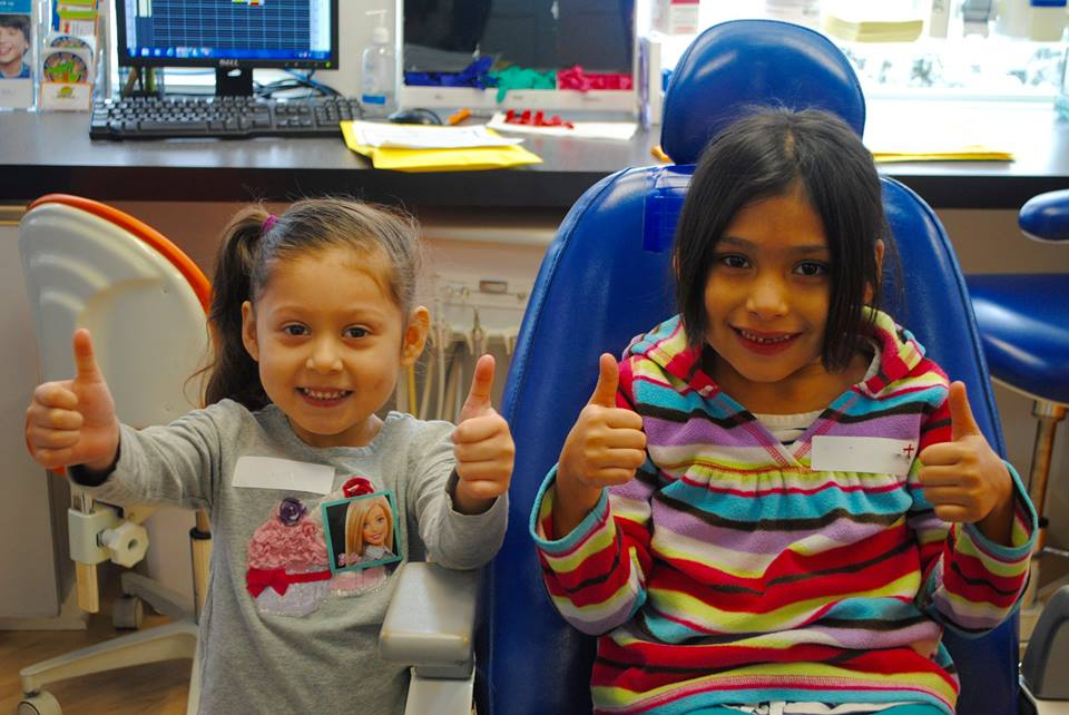 Pediatric patients showing off their smiles at Kidzdent