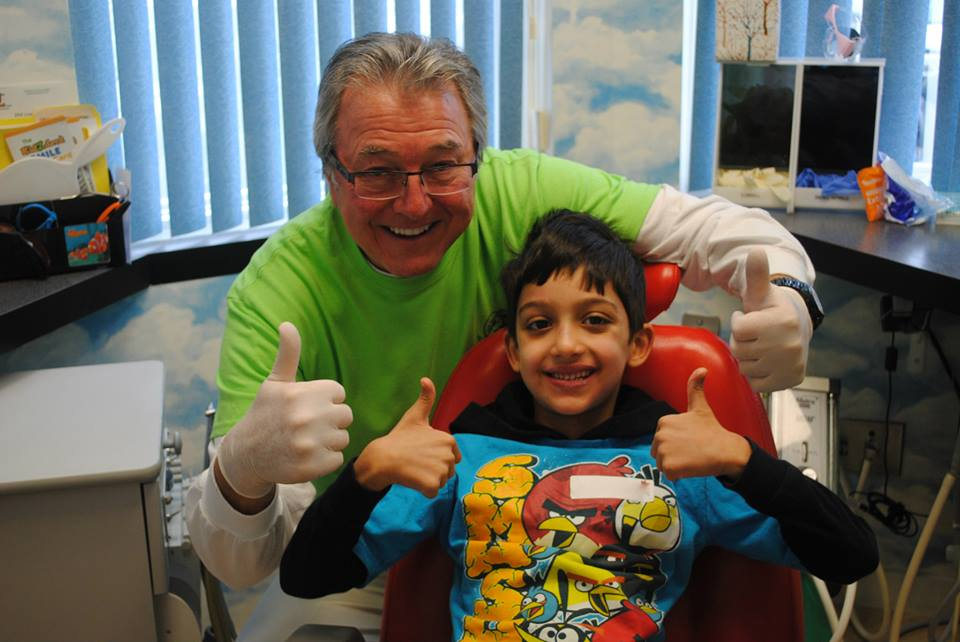 Dr. Cavan Brunsden and a pediatric patient at kidzdent smile