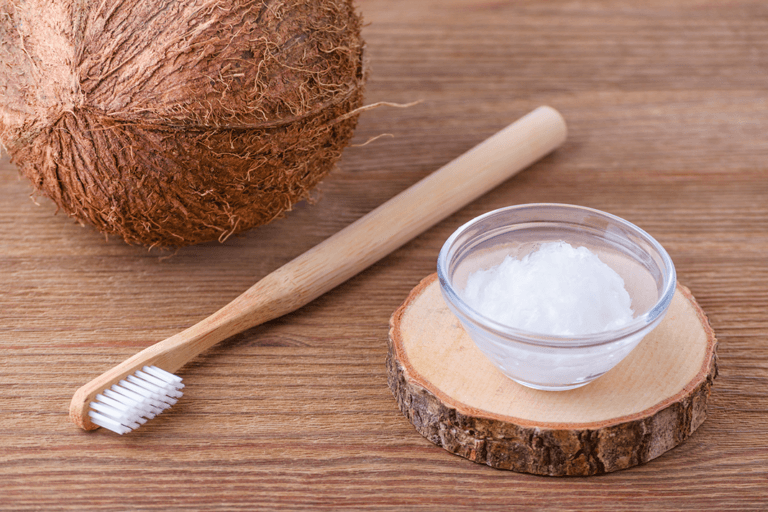 Oil Pulling picture of a toothbrush and coconut oil