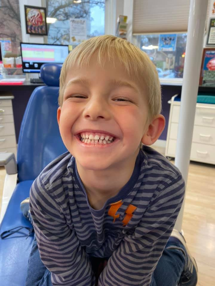 kidzdent patient smiling during an oral sedation visit
